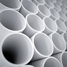white plastic cylinders as a industrial background