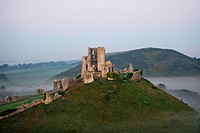 Ruins of a castle on hill, Corfe Castle, Dorset, England