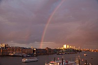 Rainbow over Docklands skyline and Thames River, Docklands, London, England