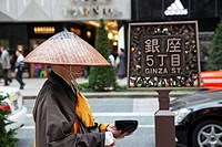 Monk collecting alms in a street, Ginza, Tokyo, Japan
