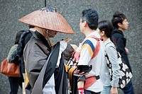 Monk collecting alms, Ginza, Tokyo, Japan