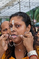 Devotee with pierced body in a religious procession at Thaipusam Festival, Sri Srinivasa Perumal Temple, Little India, Singapore