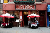 People sitting outdoors at a small italian restaurant on Mulberry Street in the Little Italy section of Lower Manhattan,New York City,New York states,...