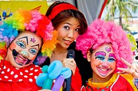 Thailand Chonburi Bull Race Woman with 2 girls made up as clowns