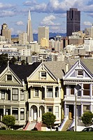 San Francisco, California - Alamo Square Victorians in Foreground, San Francisco in Background  Built in 1895, these houses are in the 700 block of St...