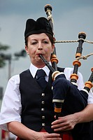 Woman playing the bagpipes at a piping competition, Dundonald Highland Games, Ayrshire,Scotland, UK, Great Britain
