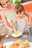 Baking _ Woman with child preparing dough
