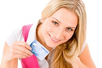 Home shopping _ young woman holding credit card