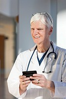 Doctor text messaging on his smartphone