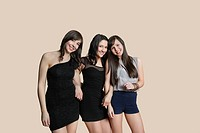 Portrait of young female friends posing over colored background