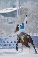 A polo player in the snow, Kitzbuehel, Tyrol, Austria, Europe