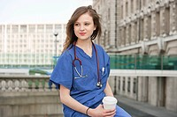 Beautiful young female doctor on a work break