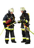 Firefighters from a fire_fighting crew wearing breathing equipment connecting two c_hoses, professional firefighters from the Berufsfeuerwehr Essen, E...