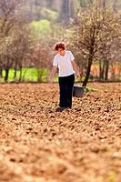 Young woman farmer planting