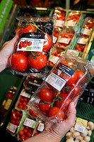 Pack of organic tomatoes, food hall, supermarket, Germany, Europe