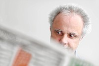 A man reading a newspaper, being astonished, North Rhine-Westphalia, Germany, Europe