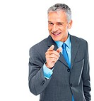 Portrait of confident mature business man pointing at you against white
