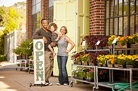 Family standing near florist open sign