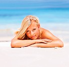 Portrait of sexy young woman resting on beach