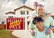 African American Family, House and Sold Sign