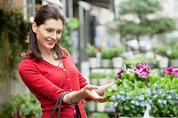 Close_up of a woman looking at flowers in a flower shop