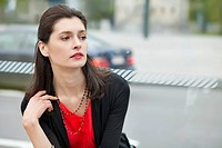Close_up of a woman waiting at bus stop