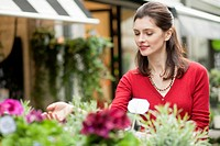 Woman touching flowers in a flower shop