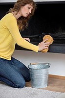 Woman cleaning fire place