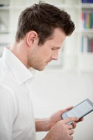 Man using an electronic book