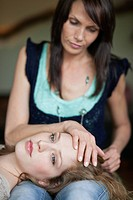 Woman lying on her mother's lap (thumbnail)