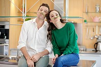 Couple playing with green bean in the kitchen (thumbnail)