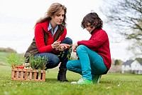 Woman and son looking at vegetables in a park (thumbnail)