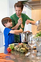 Boy assisting his father in the kitchen (thumbnail)