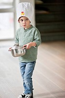 Boy carrying a saucepan