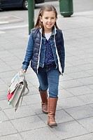 Portrait of a schoolgirl carrying schoolbag