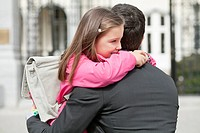 Girl hugging her father
