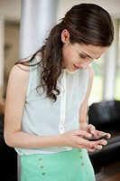 Woman using a smart phone (thumbnail)