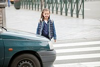 Schoolgirl crossing a road