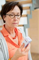 Woman reading a prescription