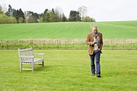 Man using a mobile phone in a field