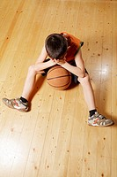 Boy with basketball on floor