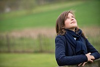 Girl looking up in a farm (thumbnail)
