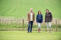 Portrait of a happy family standing in a field