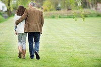 Man walking with his daughter in a park