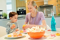 Woman and son at breakfast table (thumbnail)