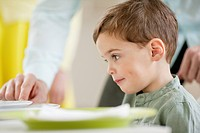 Boy sitting at a dining table