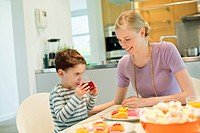 Woman and son at breakfast table