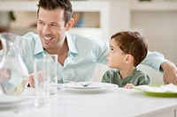 Man with his son sitting at a dining table