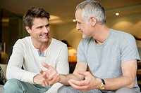 Two male friends discussing and smiling (thumbnail)