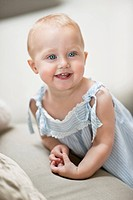 Close-up of a baby girl smiling (thumbnail)